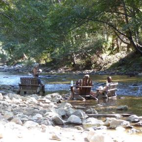 Deck chairs in the river